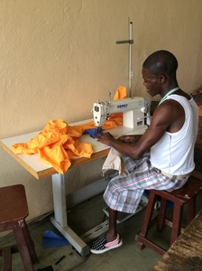 Student sewing in the domestic science departement